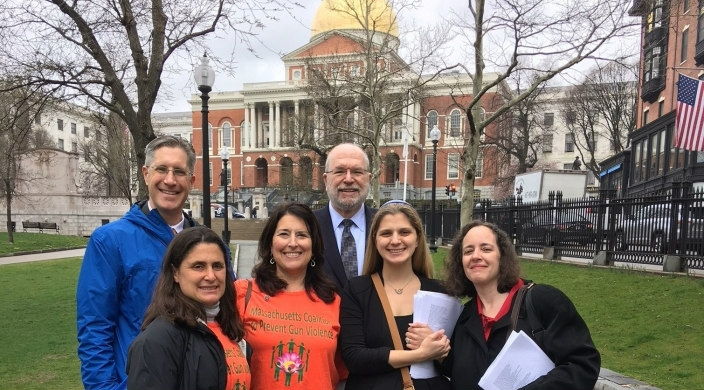 Group of rabbis standing in front of the Massachusetts statehouse