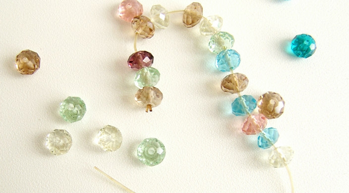 Loose beads of different colors; some strung on a string