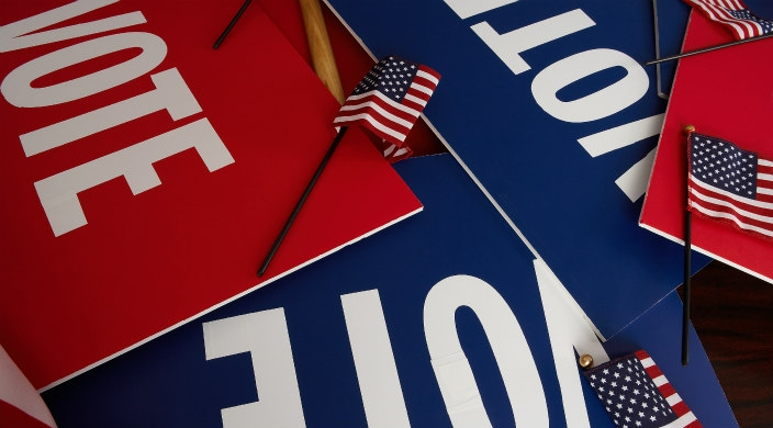 Three VOTE signs in red white and blue