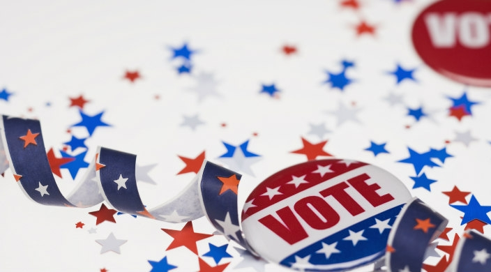 Vote buttons, streamers, and confetti, all in red, white, and blue