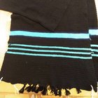 I finished crocheting the tallit for my fiancé. It's a big long, but he loves it, and that's what ultimately matters.