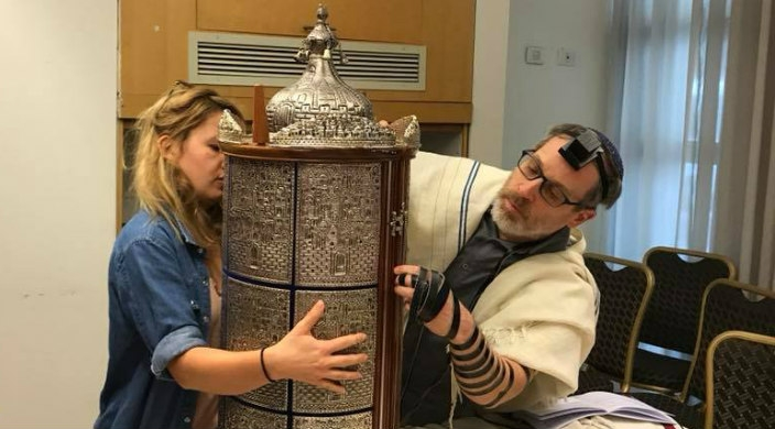 The author (wearing tefillin) and a student with a Sephardic Torah scroll