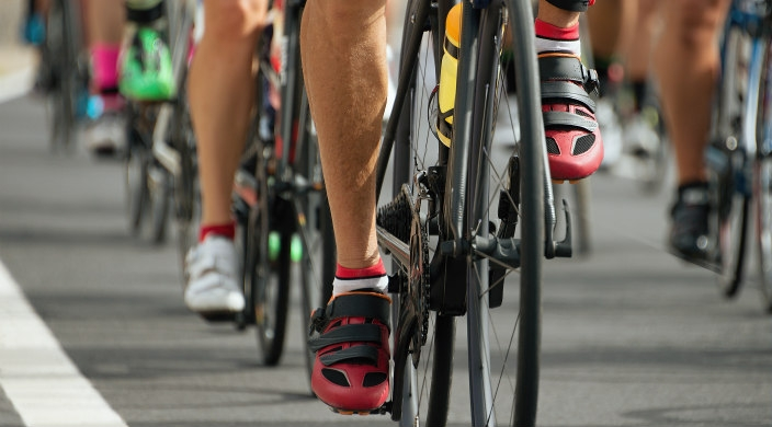 Legs, feet, and bicycles of riders in a cycling race