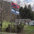 Is it correct to fly the Israeli flag above or below the Confederate battle flag?