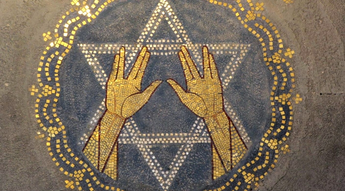 Tile sign of the Star of David with the Vulcan salute in front