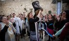 Women of the wall hide torah scroll in public bathroom and remove head covering from orthodox woman