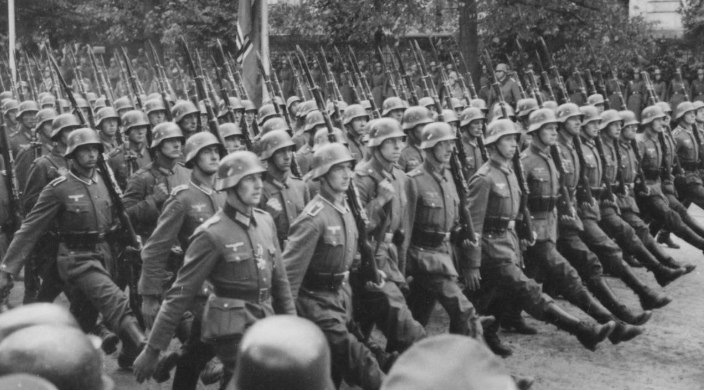 Black and white photo of the German army marching to invade Poland