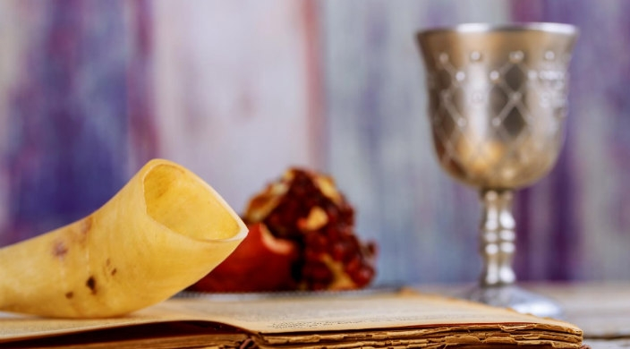 Rosh HaShanah table scene with shofar and pomegranate