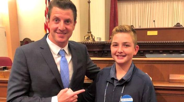 Jonah Bookman poses with his state senator