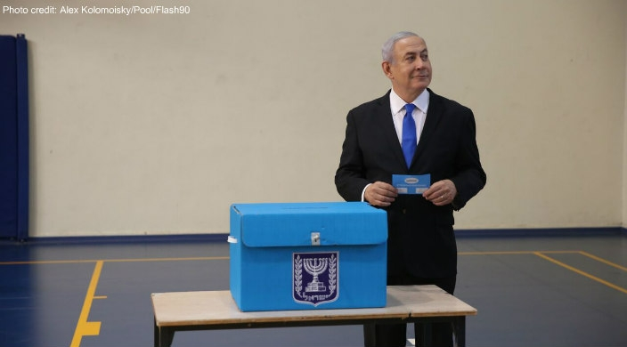 Israeli Prime Minister Benjamin Netanyahu casts his ballot at a voting station in Jerusalem