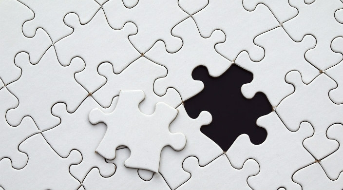 White puzzle with one piece missing