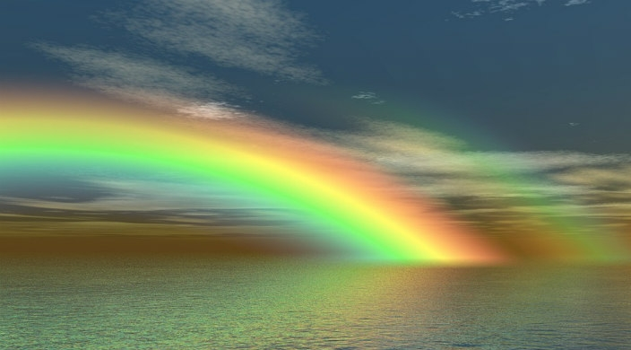 Rainbow over a body of water