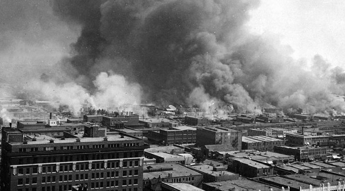 Black and white photo of the Little Africa section of Tulsa in flames during the 1921 race riot