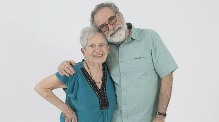 The author poses for a smiling photo with his elderly mother
