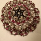 A hand-beaded Kippah I made. Feeling proud of it, wanted to share it with you all!