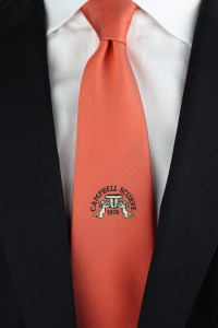Custom tie with large embroidered logo below the tie knot