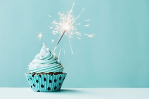 45273894 - cupcake with sparkler against blue