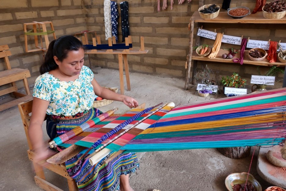 Woman weaving textiles in Guatemala