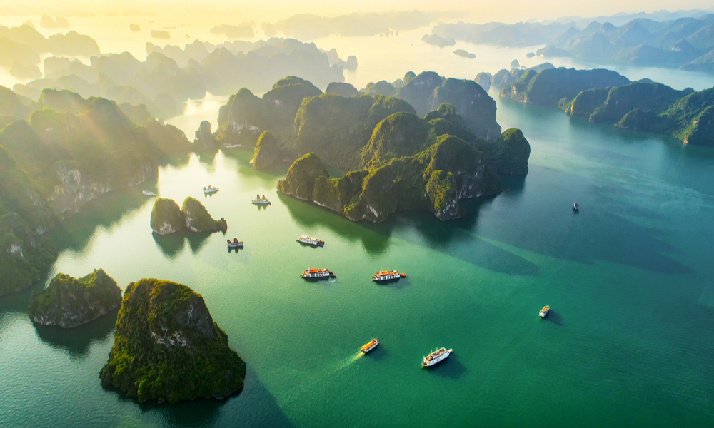 fun places to go visit in 2020:Aerial view floating fishing village and rock island, Halong Bay, Vietnam, Southeast Asia.