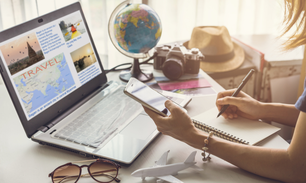How to Plan a Vacation: Girl Planning with Laptop