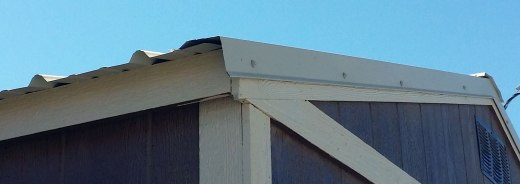 Detail showing the metal trim at the ends of the roof sheet