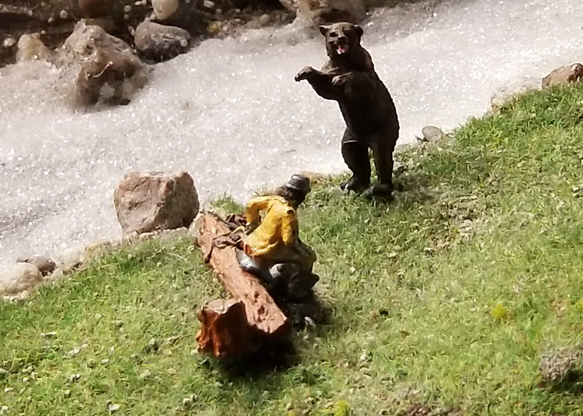 A bear catches a hiker with his pants down