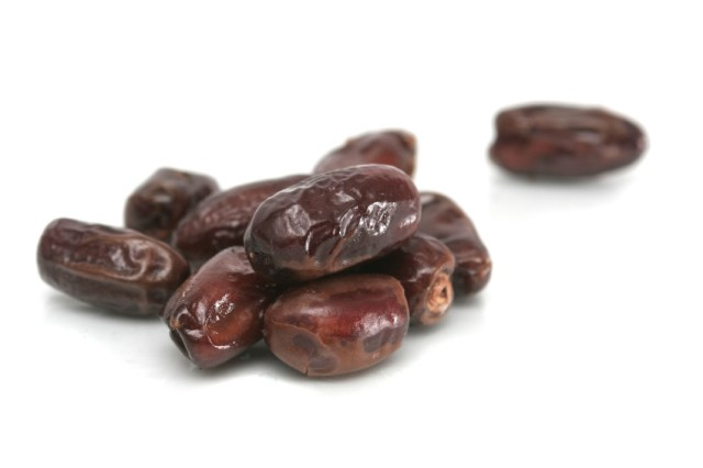 a pile of dates on a white table