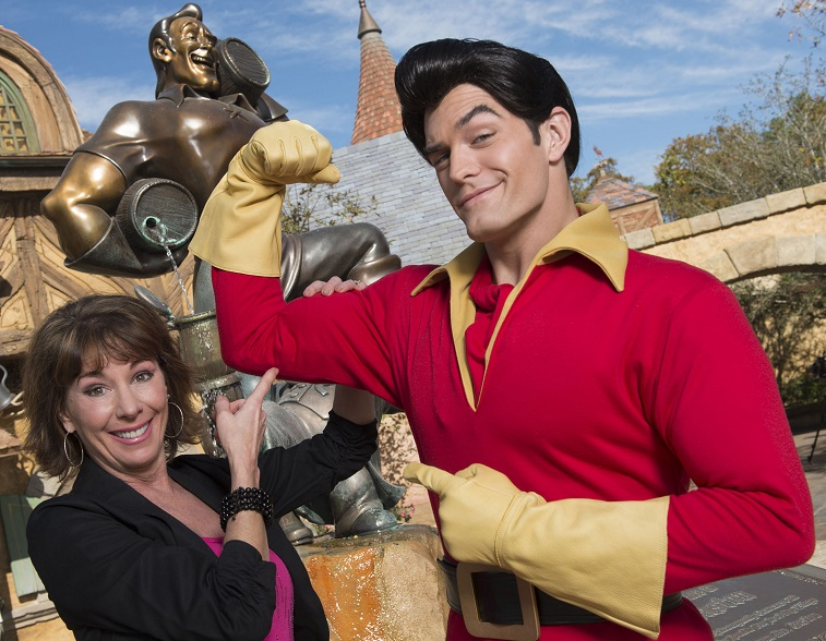 "Paige O'Hara poses with Disney's ""Beauty and the Beast"" character Gaston"