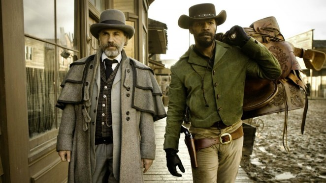 Christoph Waltz and Jamie Foxx wearing old western clothing and walking down the street in Django Unchained