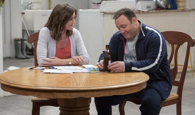 Kevin sits at a table with a beer next to his wife in Kevin Can Wait