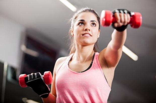Woman working out with some dumbbells.