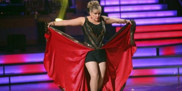 Nancy Grace holds up the skirt of her costume while dancing on Dancing With the Stars.