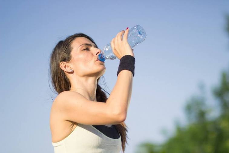 Girl drinking water bottle