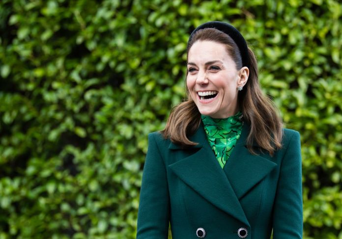 Kate Middleton laughed, wearing all the green, in front of the bush