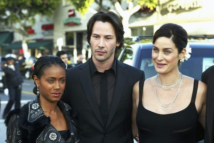 Jada Pinkett Smith, Keanu Reeves, and Carrie-Anne Moss at the premiere of The Matrix Reloaded '