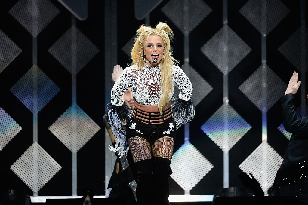 Britney Spears playing on stage, singing