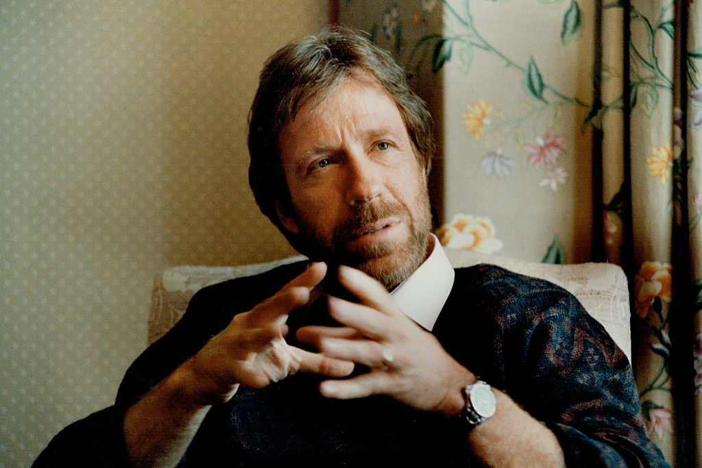Chuck Norris, turned slightly to his right, moving up while he spoke