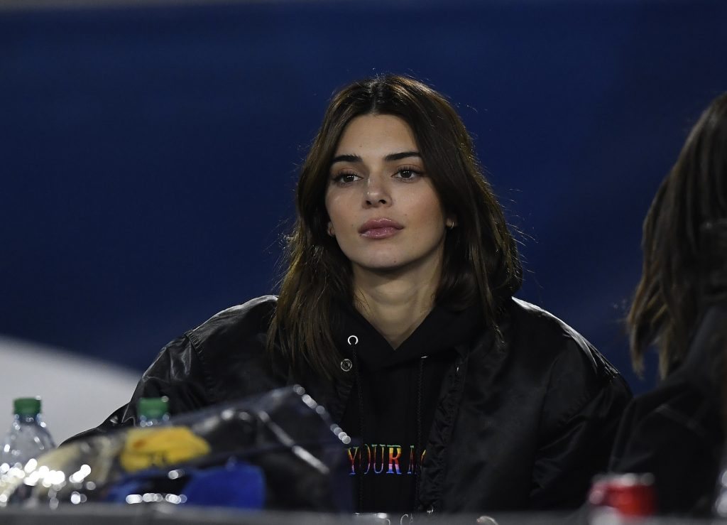 Kendall Jenner attends a football game