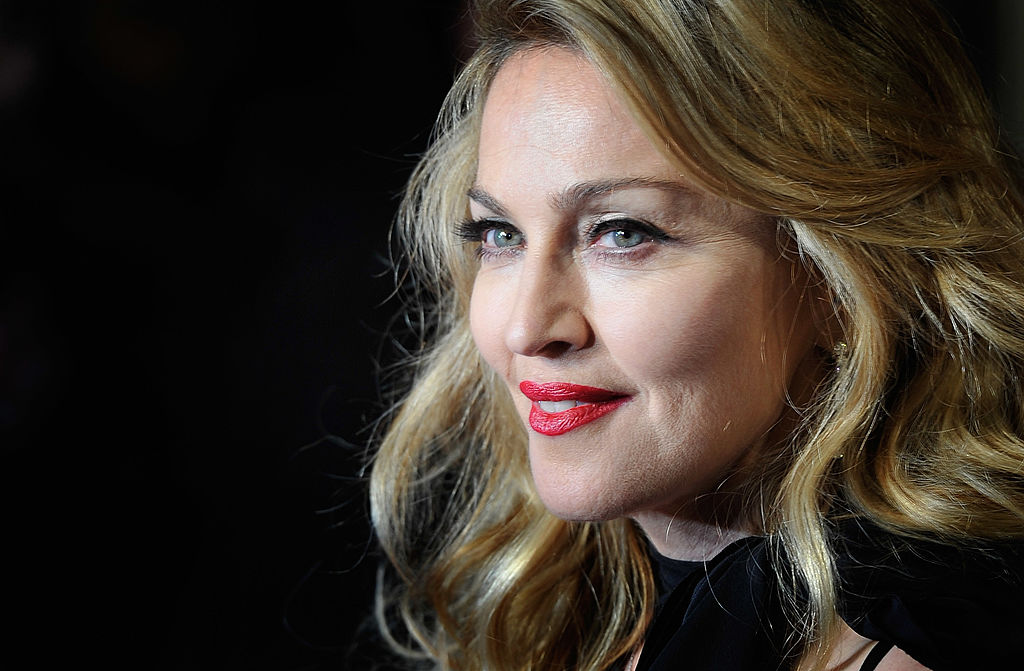 Madonna smiles, looking to the side