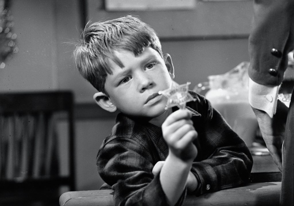 American actress Ronnie Howard appears as Opie Taylor in a program of 'The Andy Griffith Show.  '
