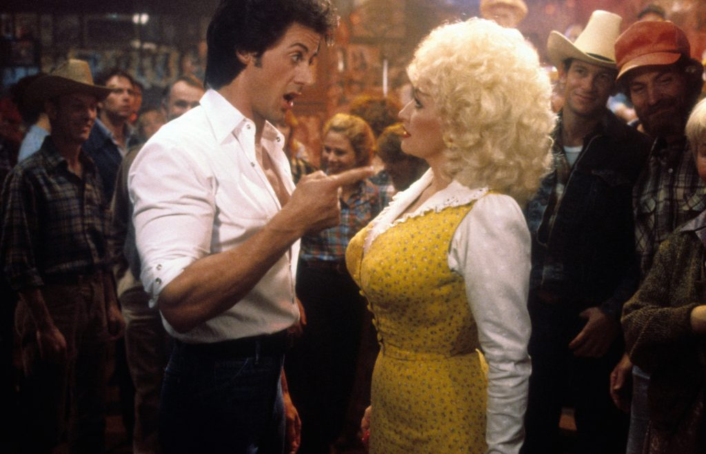 Sylvester Stallone celebrates Dolly Parton in a scene from the film 'Rhinestone'
