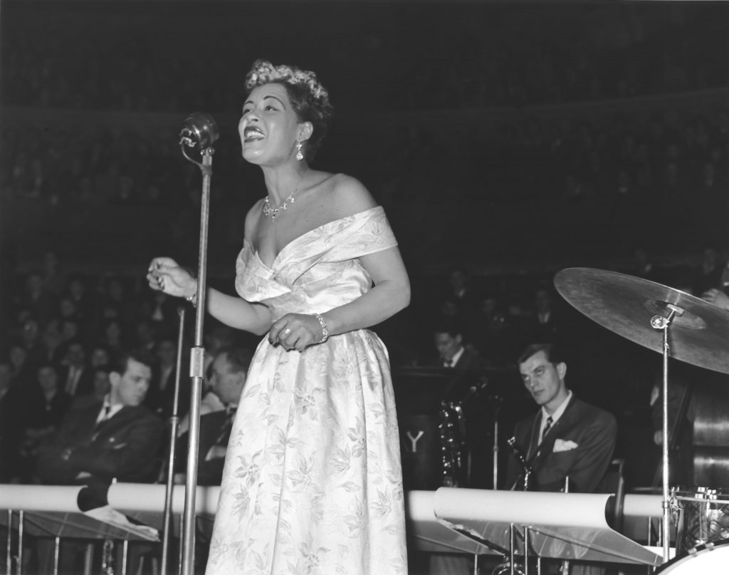 Billie Holiday performing a song on stage