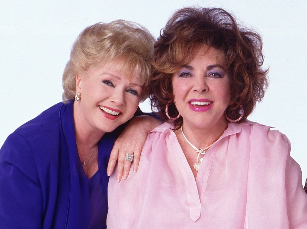 Debbie Reynolds and Elizabeth Taylor in a photo for 'These Old Broads' written by Carrie Fisher |  Timothy White / Walt Disney Television via Getty Images