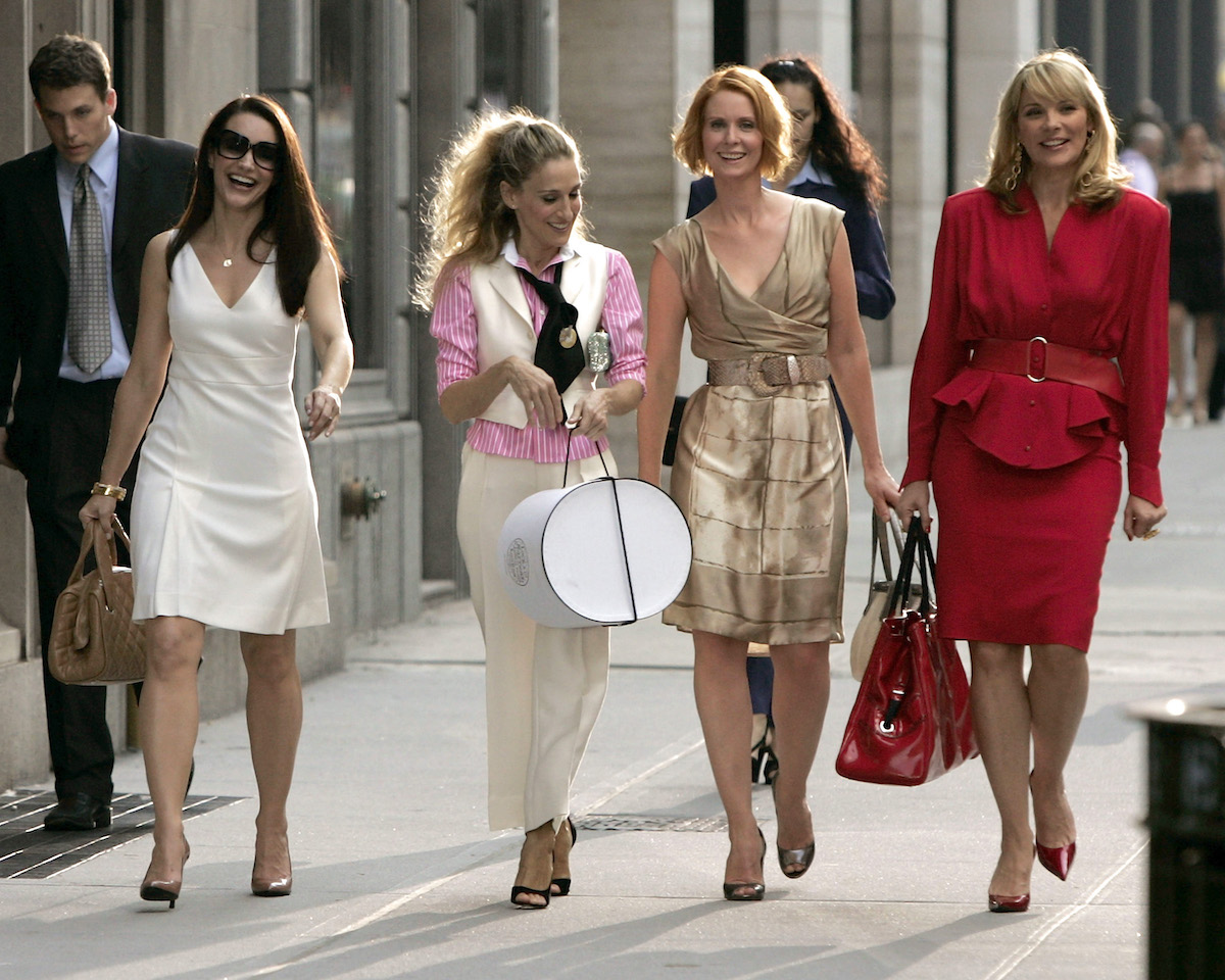 """Kristin Davis as """"Charlotte,"""" Sarah Jessica Parker as """"Carrie Bradshaw,"""" Cynthia Nixon as """"Miranda,"""" and Kim Cattrall as """"Samantha"""" on place for """"Sex and the City: The Movie"""""""