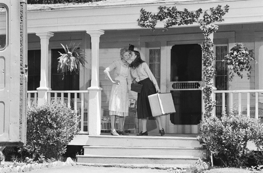(LR) Michael learned as Olivia Walton and Mary McDonough as Erin Walton on porch on 'The Waltons'