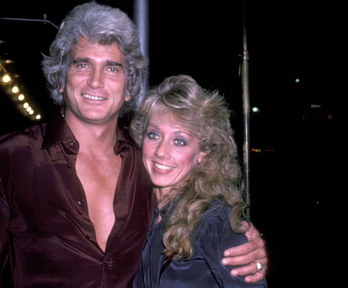 Michael Landon and his girlfriend Cindy Clerico on November 21, 1982 pose for photographs outside the Sherry Netherlands Hotel in New York City