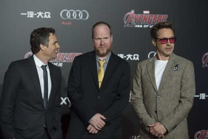 Mark Ruffalo, Joss Whedon and Robert Downey Jr. stand next to each other on the red carpet.
