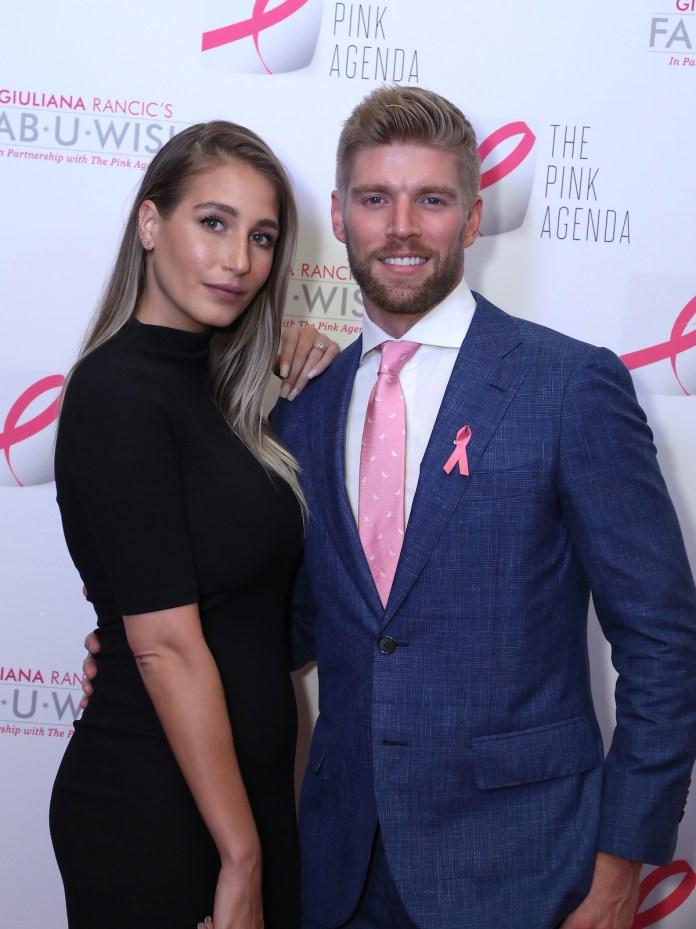 Amanda Batula and Kyle Cook posing together at an event.