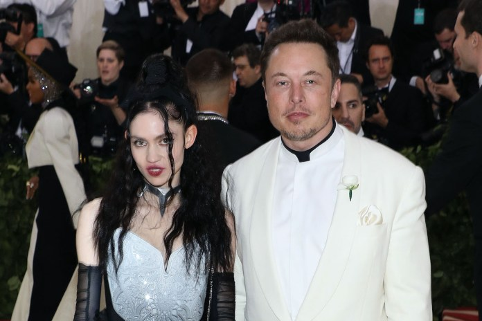 Grimes and Elon Musk posing together at the 2018 Met Gala.