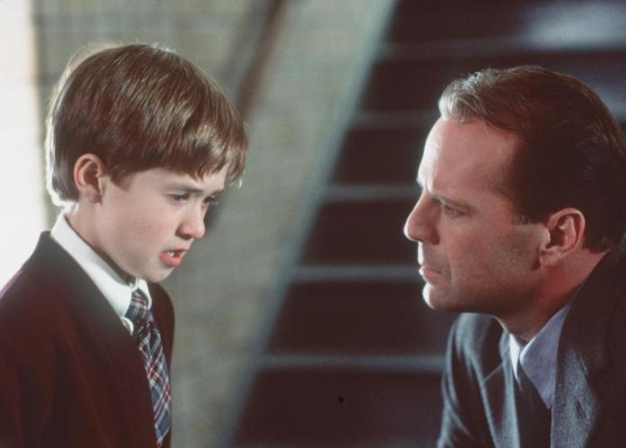 Bruce Willis watches Haley Joel Osment cry in a scene from 'The Sixth Sense'